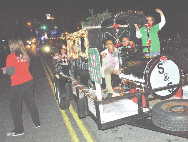 This Sunrise Sunset Child Care Center float was one of many entered in the inaugural HUBA Lighted Christmas Parade a couple years ago when temperatures were unseasonably warm.