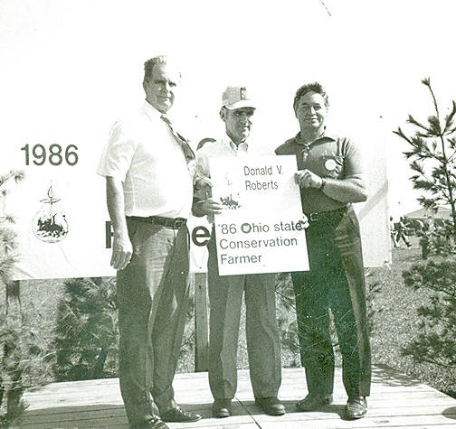 Donald V. Roberts is shown being presented with the Ohio Conservation Farmer Award at the Farm Science Review in 1986. Roberts and his fellow recipients will be honored during the Soil and Water Conservation District 75th Annual Meeting.
