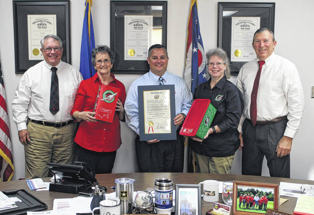From left, Highland County Commissioner Jeff Duncan stands with Lela McWhorter, Highland County Board of Commissioners President Shane Wilkin, Barbara Lanctot and commissioner Terry Britton. The commissioners on Wednesday issued a proclamation declaring November Operation Christmas Child Month.