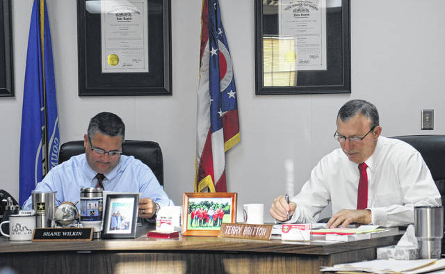 Highland County Commissioners Shane Wilkin, left, and Terry Britton sit in session during a Wednesday commissioners meeting.