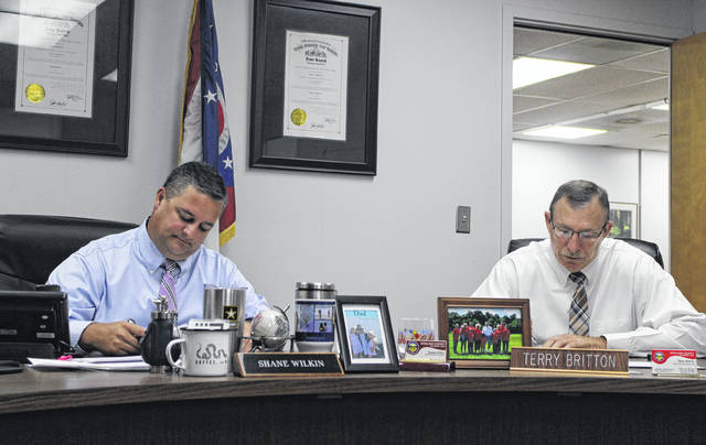 Highland County Board of Commissioners President Shane Wilkin, left, sits in session with commissioner Terry Britton during a commissioners meeting Wednesday.