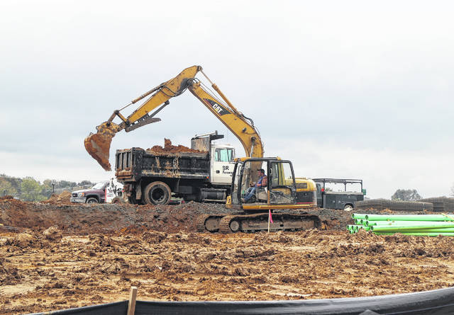 Construction crews on Thursday excavate the property between Lowe's and Walmart on Harry Sauner Road, preparing for construction of an Orscheln Farm and Home store.