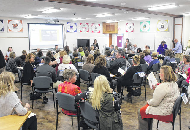 A group of more than 50 educators and other public servants gathered at the Hopewell Center in New Market on Monday morning for a poverty simulation. The event was designed to give officials a chance to experience poverty firsthand in an effort to relate with students and clients.