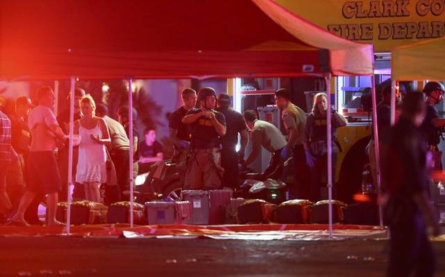 Medics treat wounded victims after a deadly shooting in Las Vegas Sunday night.