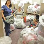 Adena caregivers purchase 1,100 coats for kids