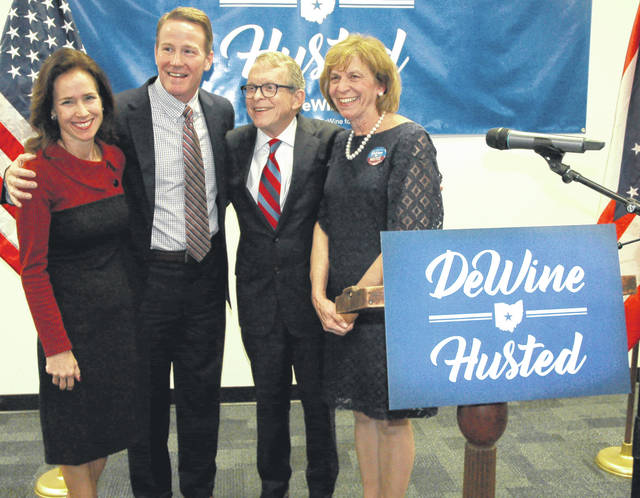 From left, Tina and Jon Husted pose with Mike and Fran DeWine Thursday after Mike DeWine announced that Jon Husted would be his running mate in the 2018 Ohio gubernatorial campaign.