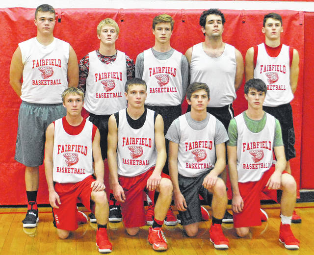 The Fairfield Lions varsity basketball team poses for a group photo in the Fairfield High School gymnasium before a preseason practice.