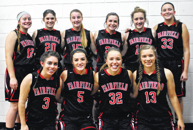 The Fairfield Lady Lions varsity basketball team poses for a team photo prior to tip off of their SHAC preview game against the North Adams Lady Green Devils. Fromt row (l-r): Ashley Sowards, Grace Shope, Blake Adams and Carlie Rieber. Back row (l-r): Lauren Arnold, Kamryn Magee, Lyndee Spargur, Molly Thackston, Samara Cannon and Brianna Barnes.