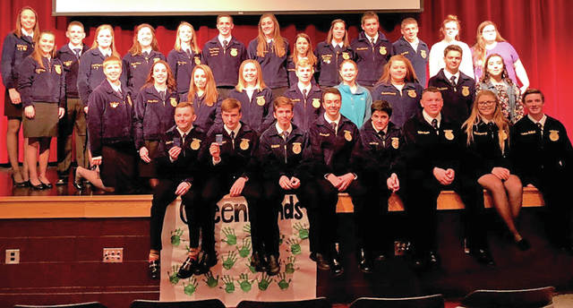 """On Nov. 16, the Hillsboro FFA Chapter held its annual Greenhand Night. At this banquet first-year members were presented with their Greenhand FFA Degree pin. This year, 23 members were recipients of this degree. In order to be eligible to receive the degree, members must be currently be enrolled in an agricultural class, have a satisfactory plan for a supervised agricultural experience, and exhibit knowledge the basic components of FFA such as FFA history, official colors, proper use of official dress, etc. The guest speaker was the Ohio State FFA President Ryan Mathews, who spoke to Greenhands and encouraged them to """"set goals, and plan to achieve them."""" Later in the program, six Greenhand members presented the FFA Creed which outlines the basic beliefs of FFA members. These students were Jonathan Hatfield, Rhen Williamson, Nick Lewis, Kelcie Thornburgh, Garrett Fannin and Zinny Adams. The banquet also consisted of a meal prepared and provided by the Hillsboro FFA and the Grover family. The meal included pulled pork, macaroni and cheese, green beans and cookies. Pictured is the Hillsboro FFA Officer Team with Greenhand members."""