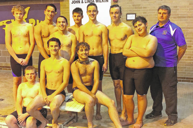 The McClain High School Tiger Sharks varsity swim team poses for a picture by the pool at McClain High School in Greenfield.
