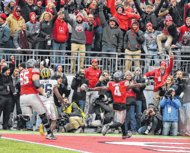 Curtis Samuel scores the winning touchdown in Ohio State's 30-27 double overtime win over Michigan last year in Ohio Stadium.