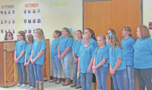 Choir performs for board