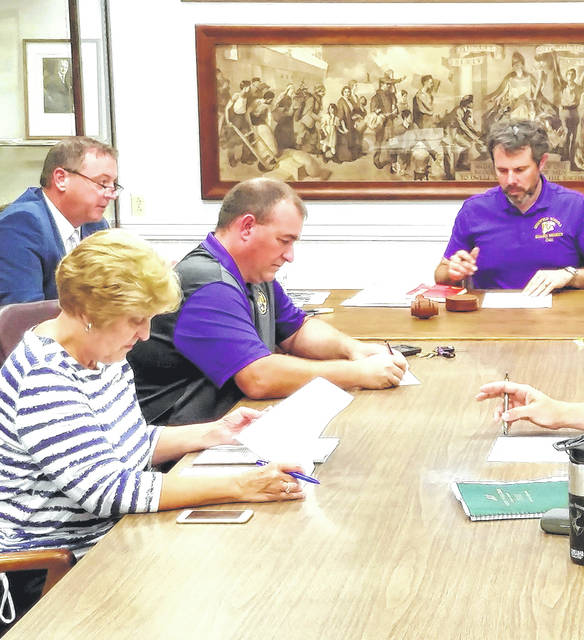 Pictured at a past Greenfield Exempted Village Schools Board of Education meeting are, from left, superintendent Joe Willis and school board members Sandy Free, Jason Allison and Eric Zint.