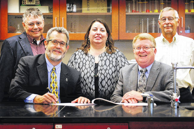 "A new Southern State Community College-Wilmington College partnership agreement to establish a ""2+2"" pathway for biology/biotechnology students was signed by school officials. Shown, seated, are Wilmington College President Jim Reynolds, left, and Southern State Community College President Dr. Kevin Boys. Standing, from left, are: Dr. Douglas Woodmansee, Wilmington College professor of Biology and Biotechnology Liaison; Dr. Erika Goodwin, Wilmington College vice president for Academic Affairs; and John Joy, SSCC North Campus director and dean of Workforce Development."