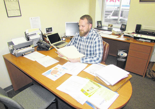Shown working at his desk is Highland County Health Commissioner Jared Warner, who recently announced the health department has been awarded a grant to stop underage tobacco use in Highland County.