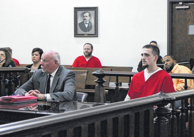 Storm Amyx, right, sits in court with defense attorney Bill Armintrout on Wednesday.