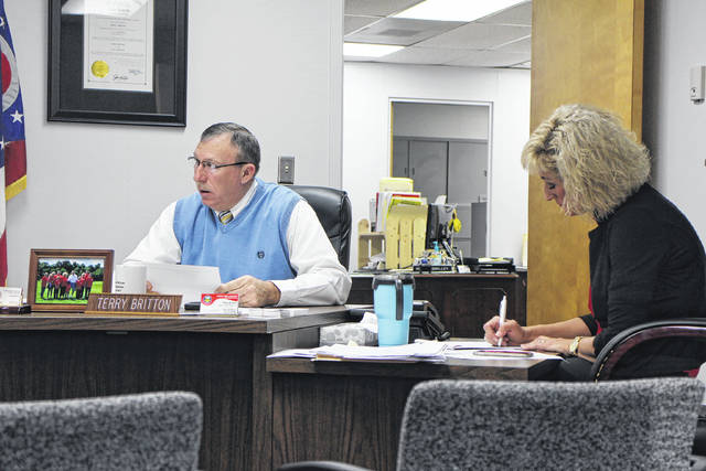 Highland County Commissioner Terry Britton, left, and commissioners clerk Rhonda Smalley sit in session during a Wednesday commissioners meeting.