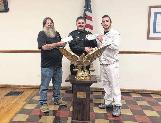 """From left, Hillsboro Fraternal Order of Eagles Aerie #1161 President Tim Tabor stands with Hillsboro Police Department Interim Chief Shawn Kelley and Hillsboro FOE Secretary Eli Hogsett. Tabor and Hogsett on Wednesday presented the HPD with two checks totalling $2,000 for equipment upgrades. Kelley told The Times-Gazette that the funds will be used to purchase a new Multi-Agency Radio Communication System (MARCS) radio for the HPD dispatch center. """"We couldn't be any happier,"""" Kelley said. """"We are absolutely excited and very thankful for it."""""""