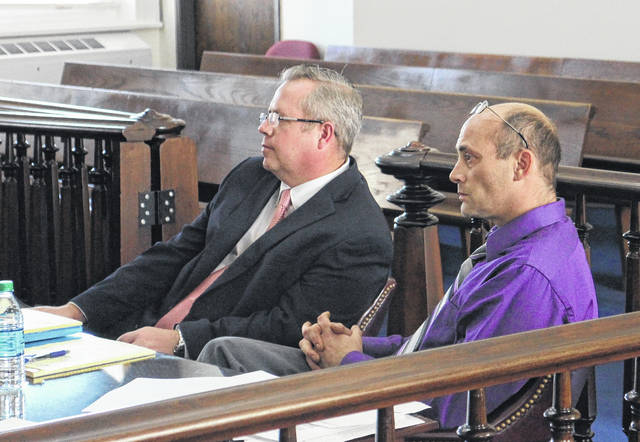 Shawn Ervin, right, sits in court with defense attorney Lee Koogler on Tuesday.