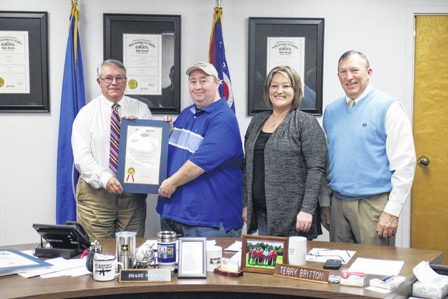 From left, Highland County Commissioner Jeff Duncan, Highland County Homeless Shelter Executive Director Greg Hawkins, shelter administrative director Tammy Hart and commissioner Terry Britton pause for a photo Wednesday after the commissioners issued a proclamation declaring Nov. 11-19 Hunger and Homelessness Awareness Week.