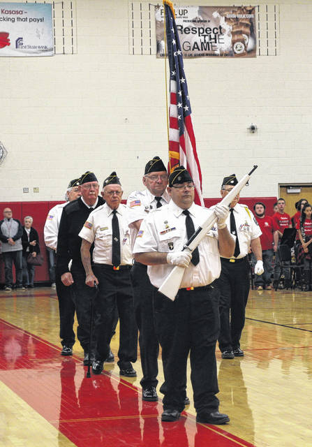 The Highland County Veterans Honor Guard prepares to post the colors on Friday at the Hillsboro High School gymnasium.
