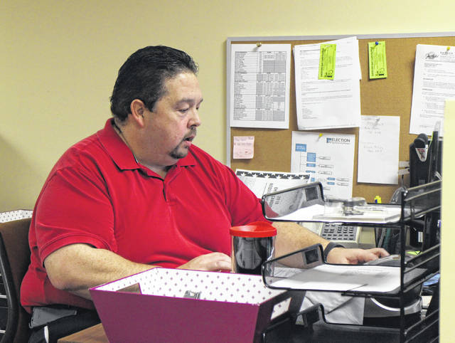 Elections Administrator Steve Witham of the Highland County Board of Elections works in the board office Tuesday morning.