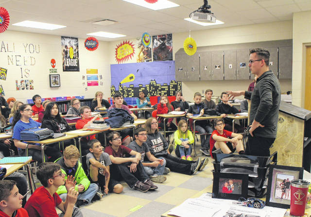 "Times-Gazette reporter David Wright, standing, speaks to students at Hillsboro Middle School Thursday morning. Wright, who joined The Times-Gazette in November of last year, spoke to 7th-grade Advanced English Language Arts students about the journalistic process, local news and his experiences as a reporter. Wright thanked teachers Carey Juillerat and Bethany Skivers for inviting him to speak. ""The students were very attentive and asked intelligent questions,"" Wright said. ""I'm happy to see youngsters having a genuine interest in local news and journalism as a whole."""