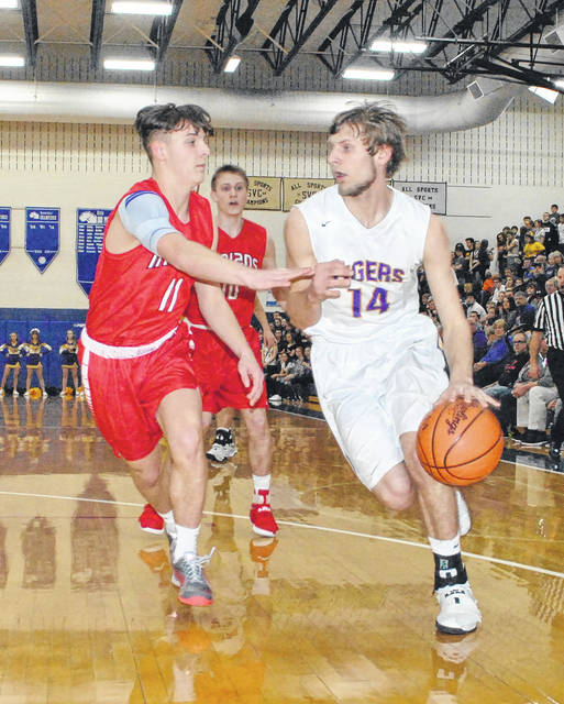 Marshall Ward (left) of Hillsboro defends against Jacob Starkey of McClain during the teams' last matchup on February 21 in a sectional tournament semi-final game. Hillsboro and McClain will square off again this weekend in the OVHC.