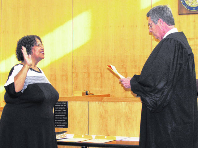 Patricia Burns, left, takes the oath of office for Hillsboro city treasurer administered by Hillsboro Municipal Court Judge David McKenna during ceremonies Thursday in the municipal courtroom.