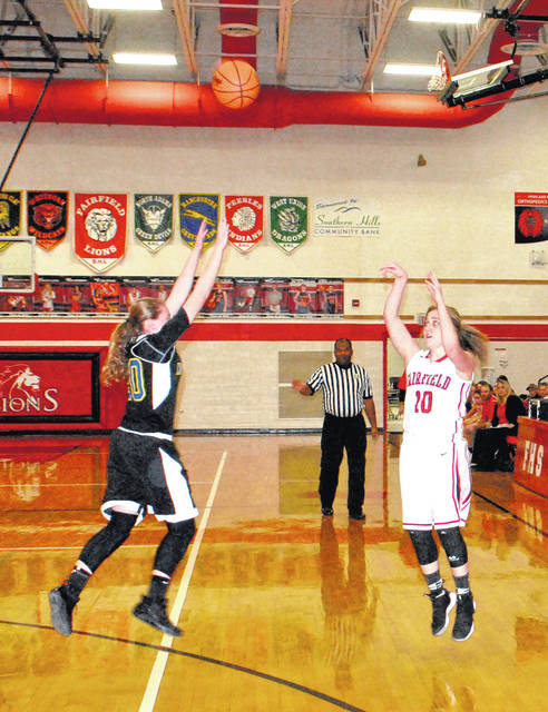 Samara Cannon launches a three pointer over the outstretched hand of a Northwest Lady Knights defender on Thursday at Fairfield High School in varsity girls basketball action.