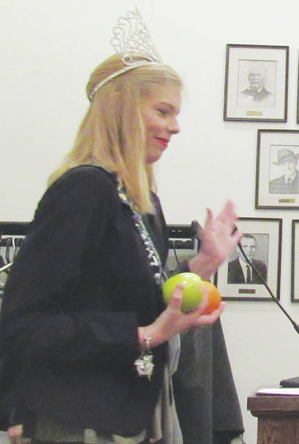 Emily Parker, the 2017 Greene Countrie Towne Festival queen, and members of her court thanked Greenfield Village Council members Wednesday by singing a Christmas carol and passing out fruit at a council meeting.