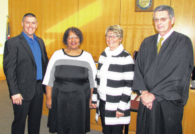 Winning Democratic Party candidates for Hillsboro city offices were sworn into office Thursday during cermonies at the Hillsboro Municipal Courtroom. Show from left are: Brandon Leeth, new at-large council member; Patty Burns, new Hillsboro city treasurer; Mary Stanforth, new 4th Ward council member; and Judge David McKenna, who administered the oaths.