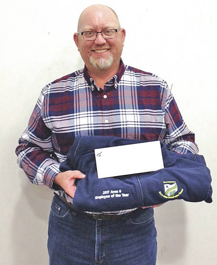 Highland Soil and Water Conservation District Employee of the Year Chuck Williams is pictured with his Service Award.