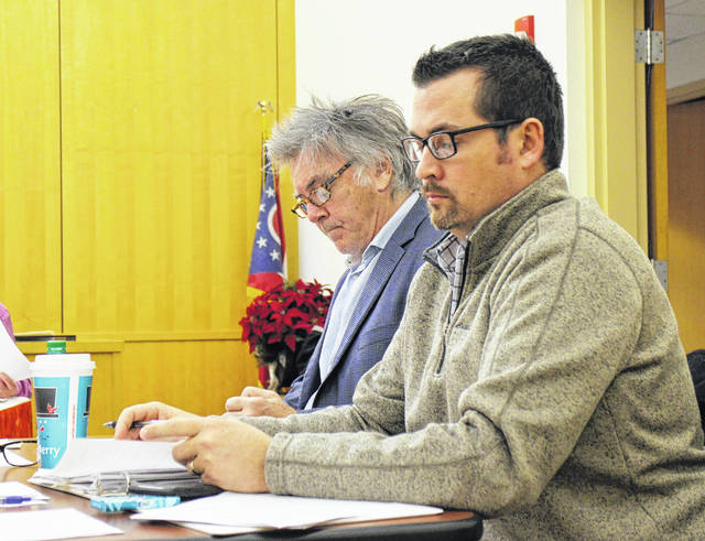 Hillsboro Safety and Service Director Mel McKenzie, foreground, sits with Hillsboro Mayor Drew Hastings during a Hillsboro City Council meeting Monday evening.