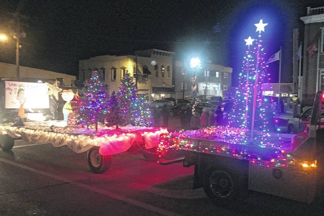 The Hillsboro Uptown Business Association's annual Christmas parade was delayed a week due to icy streets the previous week, but a good crowd was on hand to enjoy the lineup when it happened Saturday.