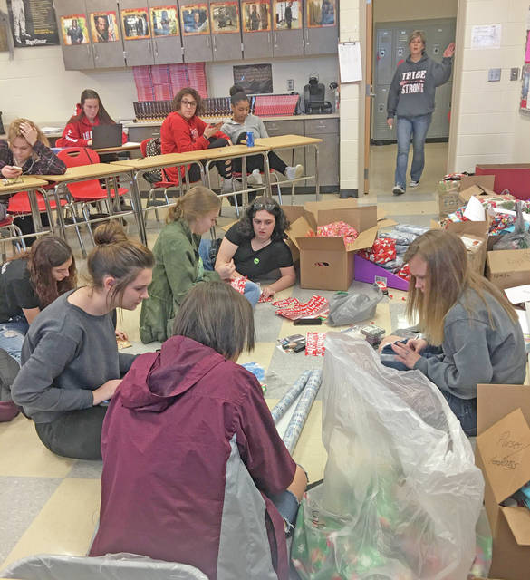 """Hillsboro High School students are pictured earlier this month wrapping presents for the """"Hillsboro to Houston Holiday Gift Drive."""""""