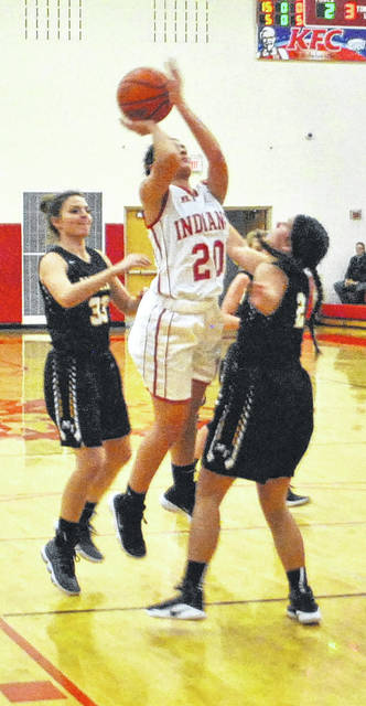 Karleigh Hopkins attempts a jump shot in the lane and gets fouled on Wednesday night at Hillsboro High School where the Lady Indians battled the Lady Panthers of Miami Trace.