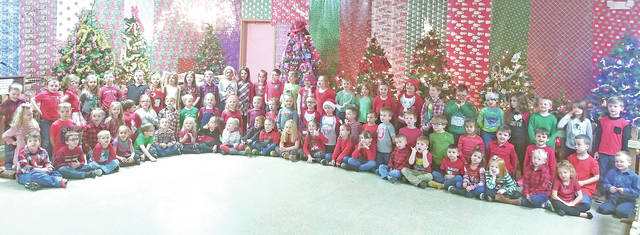 """The students in Mrs. McLaughlin, Mrs. Roberts, Mrs. Walkup and Mrs. Walters' kindergarten class at Lynchburg-Clay Elementary spread holiday cheer recently to local seniors by visiting The Highland County Senior Center, Bell Gardens and Crestwood Nursing Home. The students sang popular favorites like """"Rudolph the Red Nose Reindeer,"""" """"Jingle Bells,"""" """"Up on the Housetop"""" and """"Santa Claus is Coming to Town."""" The students also presented each facility with a Christmas tree sign made with the students' handprints and a variety of handmade crafts. The students concluded the visit by singing """"We Wish You a Merry Christmas."""""""