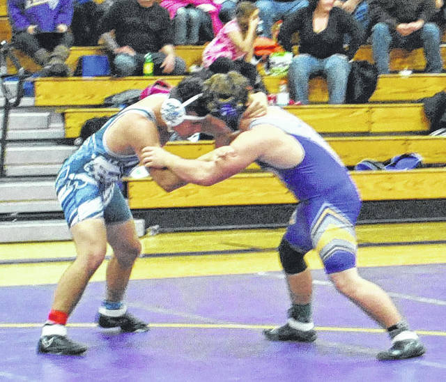 Kyler Trefz of McClain battles with Dakotah Cottrill of Adena on Thursday at McClain High School in their 182 pound wrestling match.