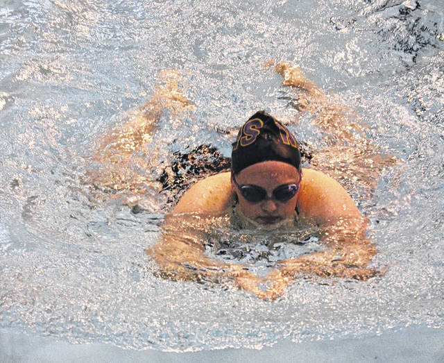 McClain Lady Tiger Shark Lauren Fabin swims in the 200-meter individual medley on Thursday at McClain High School where the Tiger Sharks were hosting the Indians in FAC swimming competition.
