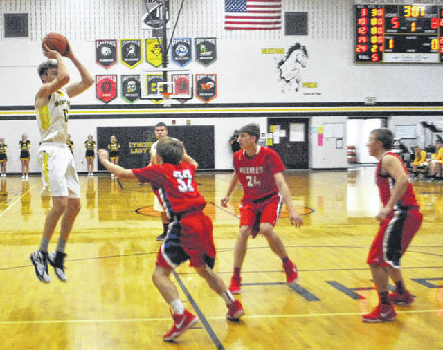 Eric McLaughlin shoots a jump shot over a Peebles defender on Friday at Lynchburg-Clay High School in a SHAC basketball matchup.