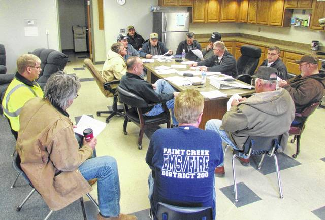 Hillsboro Mayor Drew Hastings, lower left, is shown at a previous meeting of the Paint Creek Joint EMS/Fire District board. Deals between the city and the district on continued fire and EMS coverage and Paint Creek acquiring the newer fire station appear to be close to wrapping up.