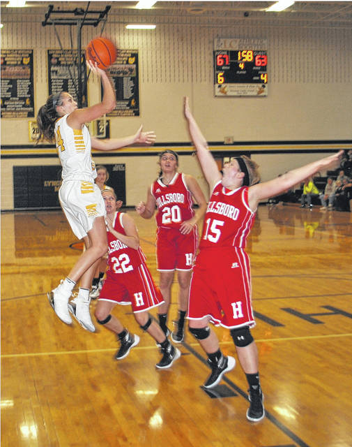 Peyton Scott elevates over Lana Grover (#15) for a floater after driving past Karleigh Hopkins (#20) and Madi Marsh (#22) at Lynchburg-Clay High School on Thursday against the Hillsboro Lady Indians.