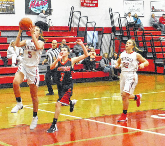 Grace Shope rises for a layup on Monday night at Fairfield High School against cross-county rivals the Lady Wildcats of Whiteoak.