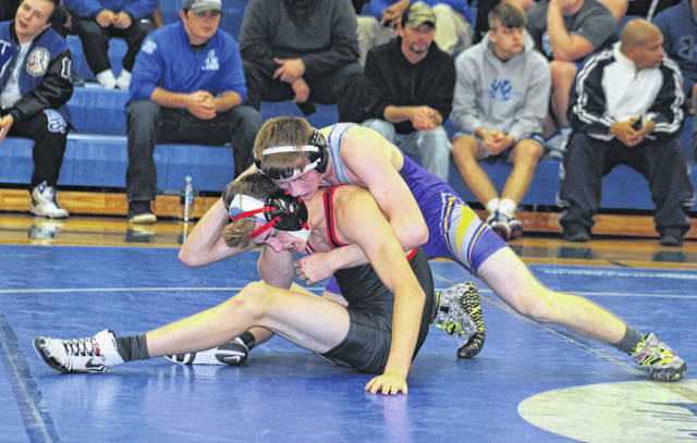 Thomas Retherford, McClains' 145-pound entrant, fights to take the back of Tippecanoe's 145-pound man during their match Thursday at Washington High School.