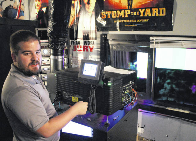 Jacob Alexander, general manager at Star Cinemas in Hillsboro, gives an inside look at one auditorium's projector system.