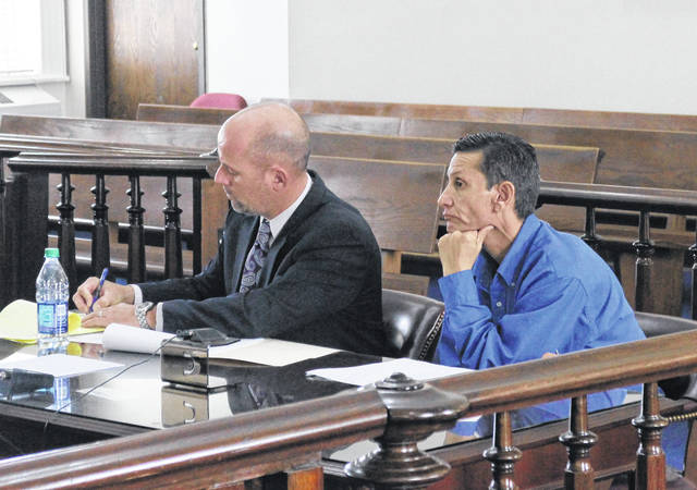 Steven Jacobs, right, sits in court with defense attorney JD Wagoner during a jury trial on Monday.