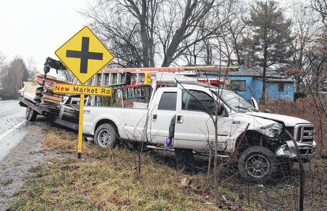 A two-vehicle wreck at the intersection of U.S. Route 62 and New Market Road late Monday afternoon did not result in injuries, but the accident had 62 down to one lane for some time. An eyewitness on the scene said it appeared as though a burgundy late-model Jeep was attempting to turn onto U.S. 62 from the parking lot of a nearby gas station when it was struck by a white Ford truck hauling a trailer loaded with lumber and heavy equipment. The truck apparently attempted to stop, the eyewitness said, but it began to slide on the wet road, and ended up in a ditch across the oncoming lane. Emergency workers on the scene said no injuries were reported. No further information was immediately available.