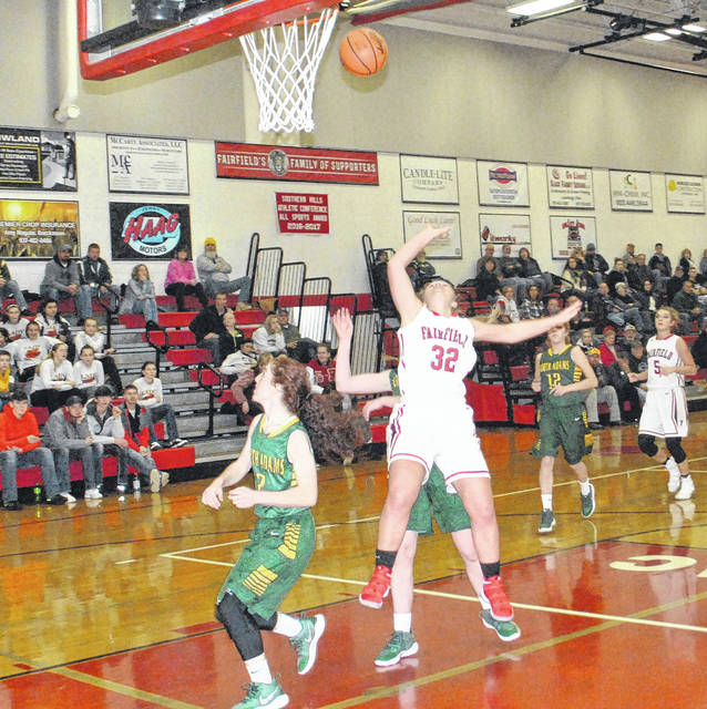 Fairfield's Blake Adams draws a foul while attempting a fast break layup on Thursday at Fairfield High School where the Lady Lions took on the North Adams Lady Green Devils in SHAC basketball action.