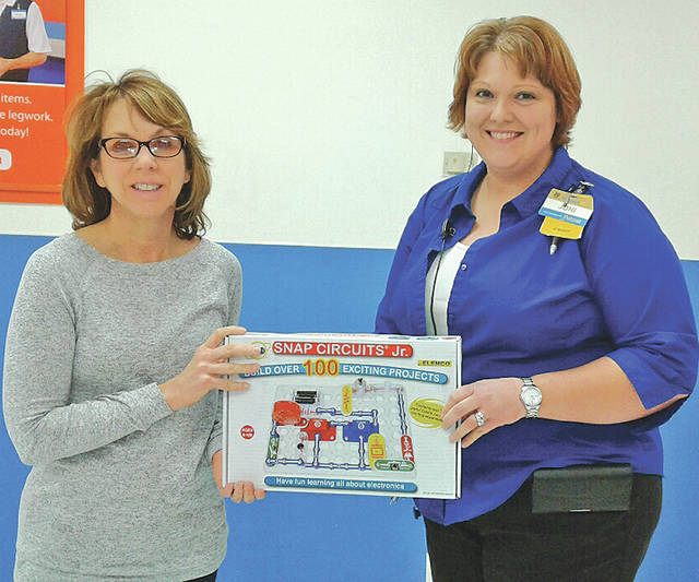 Bright Local teacher Sharon Bick, left, and Walmart co-manager Joni Palmer hold an Electric Snap Circuit, Jr. set that was purchased with a grant from Walmart. Walmart recently awarded a $250 grant to the school for the purchase of science supplies for a unit on electricity, heat and matter. The grant provided for the purchase of several Electric Snap Circuit, Jr. sets as well as books and other supplies.